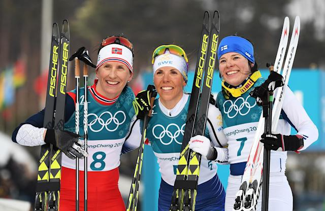 <p>Gold medalist Charlotte Kalla of Sweden (center) with silver medalist Marit Bjoergen of Norway (left), and bronze medalist Krista Parmakoski of Finland (right) pose after the Ladies Cross Country Skiing 7.5km + 7.5km Skiathlon . </p>