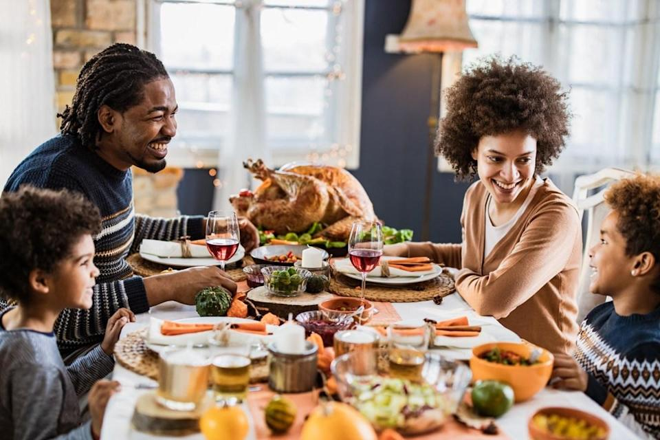 """<span>Turkey is rich in </span><span>tryptophan</span><span>, an animo acid that your body turns into a B vitamin called niacin. """"Niacin plays a key role in creating serotonin, a neurotransmitter that's associated with sleep and melatonin levels,"""" <a href=""""https://www.sleep.org/articles/what-is-tryptophan/"""" rel=""""nofollow noopener"""" target=""""_blank"""" data-ylk=""""slk:The National Sleep Foundation"""" class=""""link rapid-noclick-resp"""">The National Sleep Foundation</a> explains.</span> <span>But it's not just the turkey that makes you want to take a post-Thanksgiving meal nap. It's also your stuffing and potatoes, because eating carbohydrates allows tryptophan to easily enter the brain, speeding up the serotonin production process. And if you're adding alcohol into the mix, it's no wonder you can barely keep your head up.</span>"""