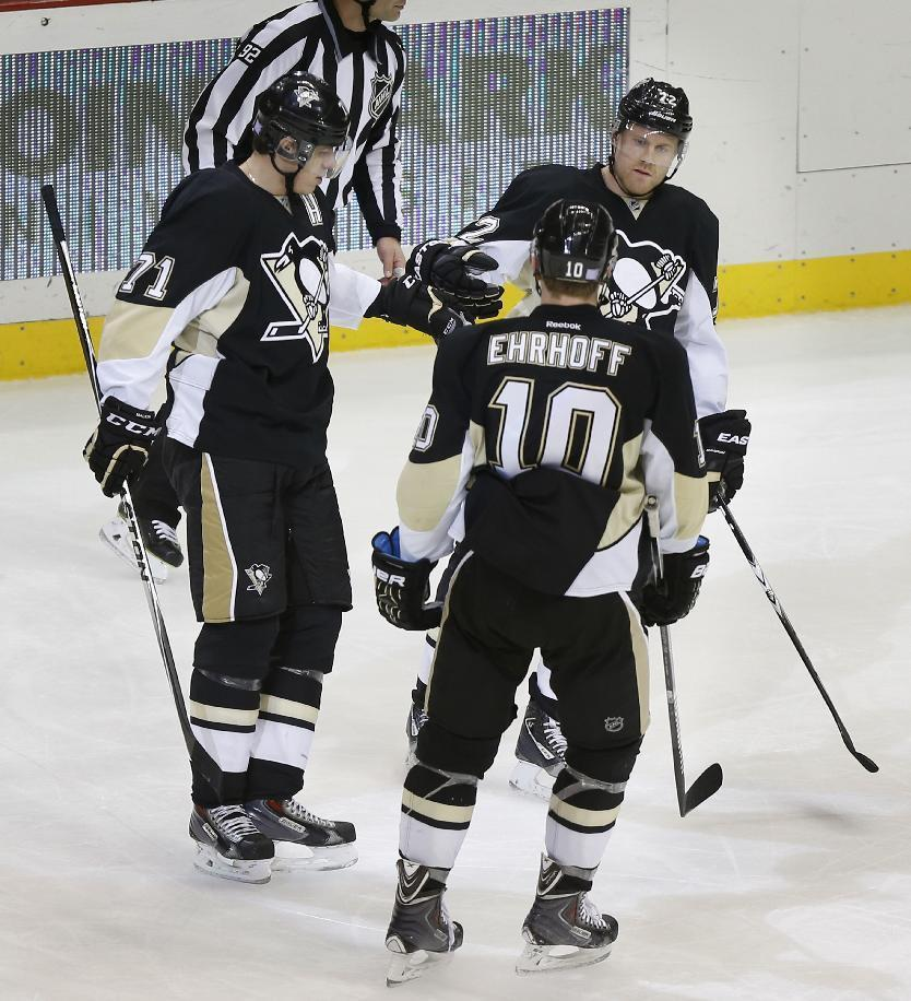 Pittsburgh Penguins' Evgeni Malkin (71) is greeted by teammates Patric Hornqvist (72) and Christian Ehrhoff after scoring a goal against the Buffalo Sabres during the third period of an NHL hockey game, Saturday, Nov. 1, 2014 in Pittsburgh. The Penguins won 5-0. (AP Photo/Keith Srakocic)