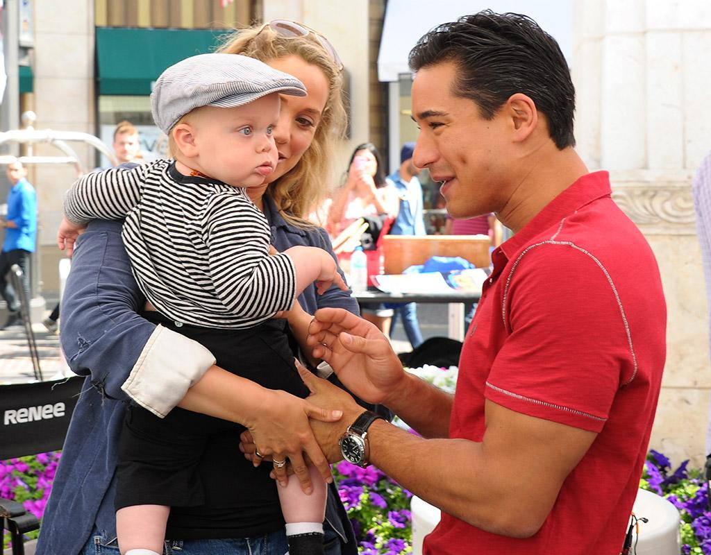 "LOS ANGELES, CA - JUNE 06:  (L-R)Elizabeth Berkley, her son Sky Cole Lauren and Mario Lopez visit ""Extra"" at The Grove on June 6, 2013 in Los Angeles, California.  (Photo by Noel Vasquez/Getty Images for Extra)"