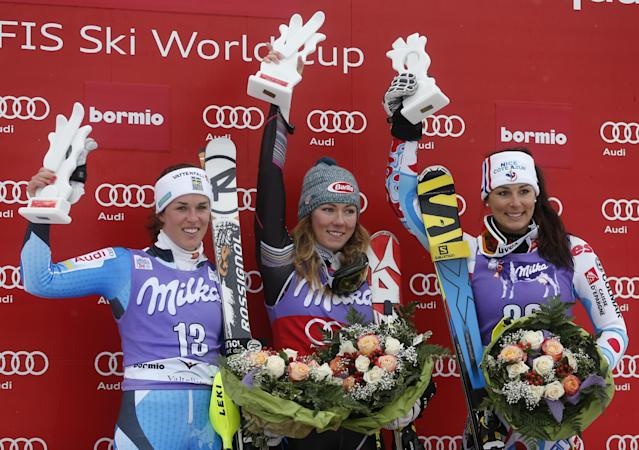 Mikaela Shiffrin, of the United States, center, the winner, second placed Maria Pietilae Holmner, left, of Sweden, and third-placed Nastasia Noens, of France, celebrate on podium after an alpine ski, women's World Cup slalom, in Bormio, Italy, Sunday, Jan. 5, 2013. (AP Photo/Marco Trovati)