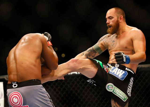 BOSTON, MA - AUGUST 17: Travis Browne kicks Alistair Overeem in their heavyweight bout at TD Garden on August 17, 2013 in Boston, Massachusetts. (Photo by Jared Wickerham/Getty Images)