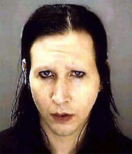 One of music's undead superstars, rocker Marilyn Manson is rarely seen without his signature pale foundation, dark lipstick and black eye liner. But when you do catch him with a clean face, he kind of has a Nic Cage thing going on?