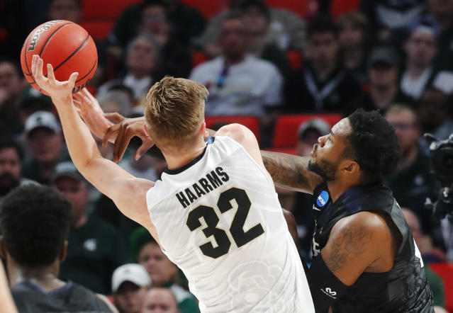 Purdue forward Matt Haarms (32) shoots on Butler forward Tyler Wideman (4) during the first half of an NCAA men's college basketball tournament second-round game in Detroit, Sunday, March 18, 2018. (AP Photo/Paul Sancya)