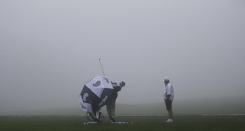 Vijay Sing, of the Fiji Islands, warms up for the fog-delayed start to the third round of Farmers Insurance Open golf tournament, Saturday, Jan. 26, 2013, in San Diego. (AP Photo/Lenny Ignelzi)