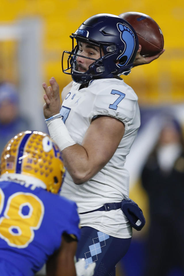 North Carolina quarterback Sam Howell (7) passes as Pittsburgh linebacker Cam Bright (38) pressures him during the first half of an NCAA football game, Thursday, Nov. 14, 2019, in Pittsburgh. (AP Photo/Keith Srakocic)