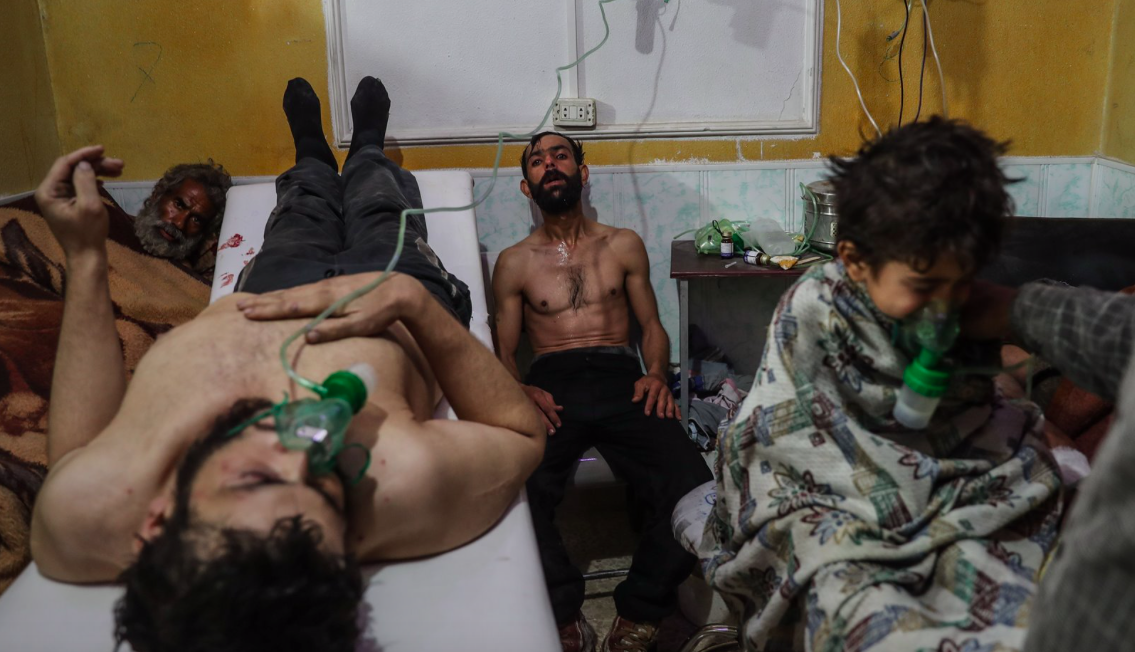 <p>Wounded people receive treatment after the suspected gas attack on al-Shifunieh, Syria. (Mohammed Badra) </p>