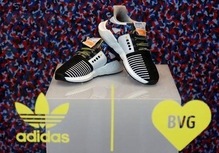 The Adidas limited-edition sneakers that match the Berlin subway seat design, and include a yearly travel pass, are displayed at the 'Overkill' shoe store in Berlin, Germany January 16, 2018. REUTERS/Fabrizio Bensch/Files