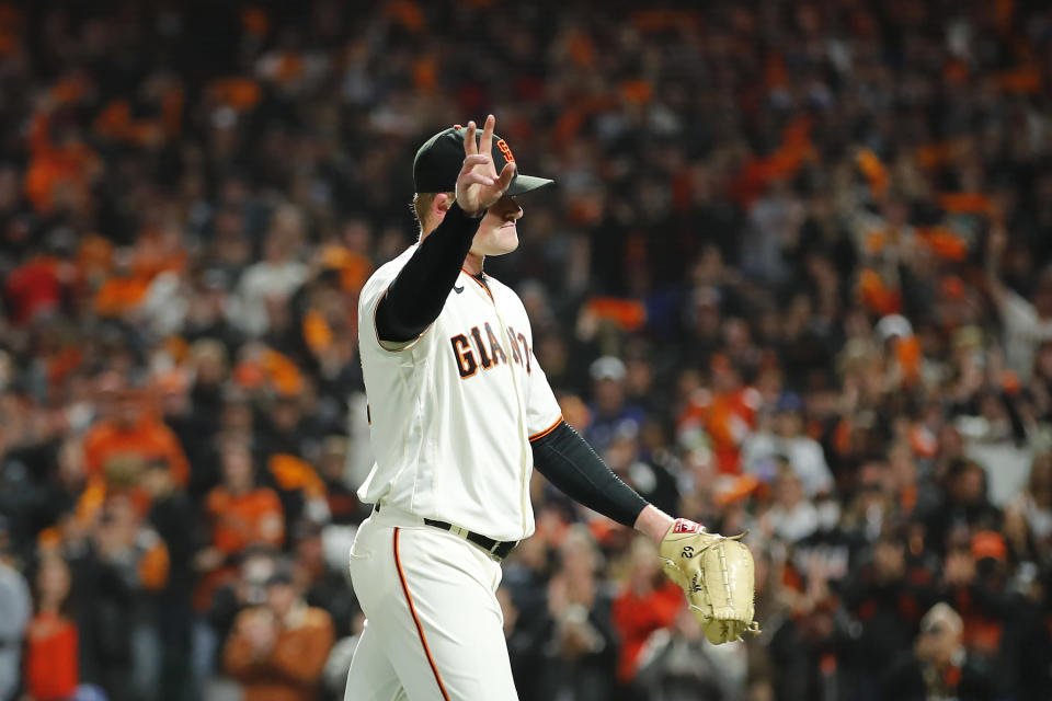 San Francisco Giants pitcher Logan Webb waves as he walks toward the dugout after being relieved during the eighth inning of Game 1 of a baseball National League Division Series against the Los Angeles Dodgers Friday, Oct. 8, 2021, in San Francisco. (AP Photo/John Hefti)