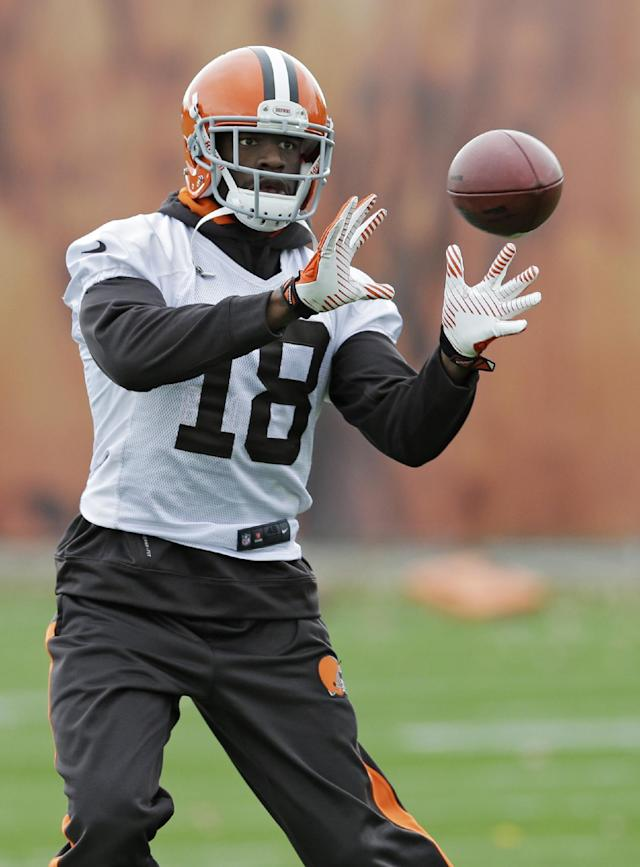 Cleveland Browns wide receiver Greg Little catches a pass during practice at the NFL football team's facility in Berea, Ohio Wednesday, Nov. 6, 2013. (AP Photo/Mark Duncan)