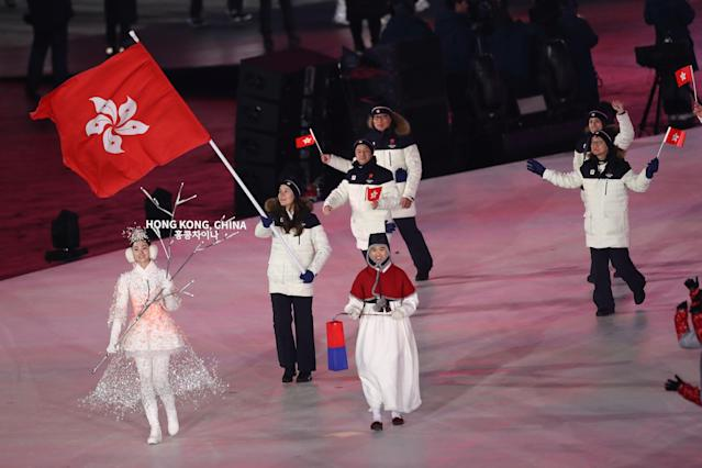 <p>Flag bearer Arabella Caroline Yili Ng of Hong Kong, China leads the team during the Opening Ceremony of the PyeongChang 2018 Winter Olympic Games at PyeongChang Olympic Stadium on February 9, 2018 in Pyeongchang-gun, South Korea. (Photo by Ronald Martinez/Getty Images) </p>