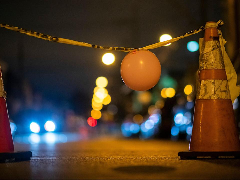 A makeshift temporary barrier created by activists is placed in the street near the 18th Precinct Police Department during a citywide curfew on 28 October 28 in Philadelphia (Getty Images)