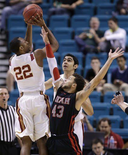USC's Byron Wesley (22) shoots over Utah's Cedric Martin (43) as USC's Omar Oraby looks on in the first half during a Pac-12 tournament NCAA college basketball game on Wednesday, March 13, 2013, in Las Vegas. (AP Photo/Julie Jacobson)