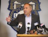Rochester Police Locust Club President Mike Mazzeo speaks with the media in Rochester
