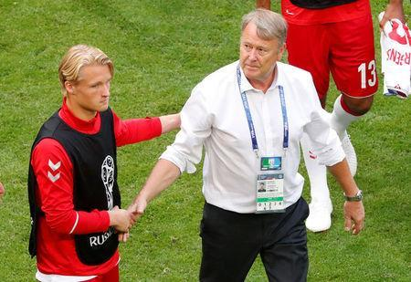 Soccer Football - World Cup - Group C - Denmark vs Australia - Samara Arena, Samara, Russia - June 21, 2018 Denmark coach Age Hareide shakes hands with Kasper Dolberg after the match REUTERS/David Gray