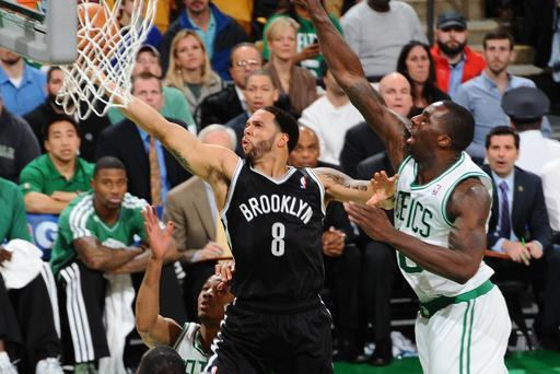 BOSTON, MA - APRIL 10: Deron Williams #8 of the Brooklyn Nets shoots a layup against Brandon Bass #30 of the Boston Celtics on April 10, 2013 at the TD Garden in Boston, Massachusetts. (Photo by Steve Babineau/NBAE via Getty Images)