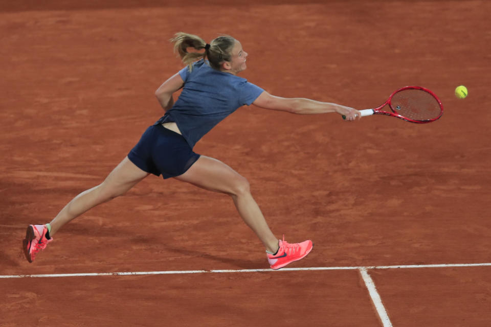 France's Fiona Ferro plays a shot against Sofia Kenin of the U.S. in the fourth round match of the French Open tennis tournament at the Roland Garros stadium in Paris, France, Monday, Oct. 5, 2020. (AP Photo/Michel Euler)