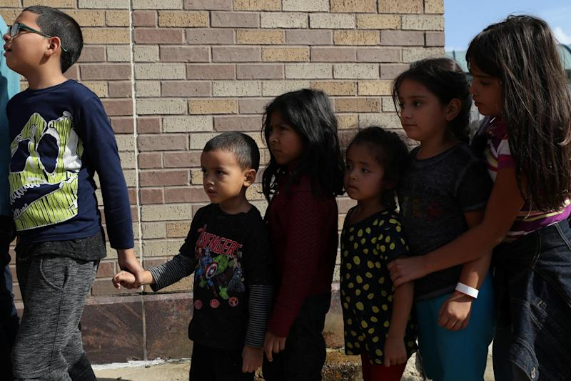 Children form a line as undocumented immigrant families are released from detention at a bus depot in McAllen, Texas, U.S., June 22, 2018: REUTERS