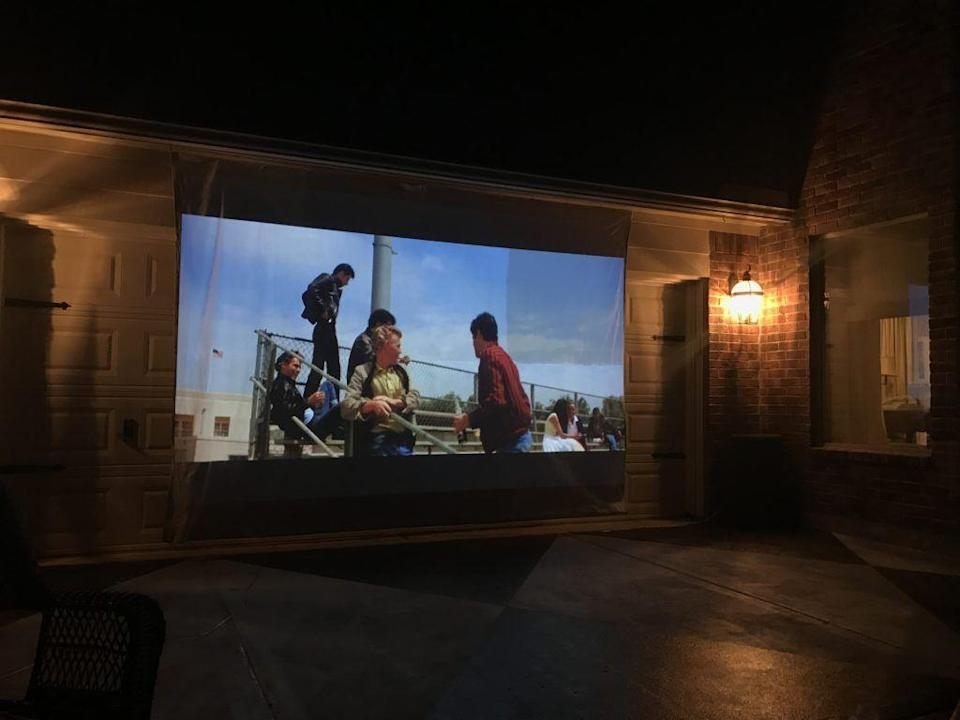 """<p>This DIY movie screen doubles as an art project, because it involves <a href=""""https://www.theaspiringhome.com/6-steps-diying-outdoor-movie-screen/"""" rel=""""nofollow noopener"""" target=""""_blank"""" data-ylk=""""slk:painting a canvas drop cloth white"""" class=""""link rapid-noclick-resp"""">painting a canvas drop cloth white</a> in order to reflect a high quality picture. The Aspiring Home provides a tutorial and a list of supplies needed, such as a sewing machine and paint brushes.</p><p><strong>See more at <a href=""""https://www.theaspiringhome.com/6-steps-diying-outdoor-movie-screen/"""" rel=""""nofollow noopener"""" target=""""_blank"""" data-ylk=""""slk:The Aspiring Home"""" class=""""link rapid-noclick-resp"""">The Aspiring Home</a>.</strong></p>"""