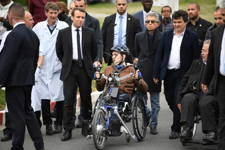 and director of the Seine-Saint-Denis' Chamber of trades and crafts Patrick Toulmet (R) and French writer, activist and specialist of emergency medical services Patrick Pelloux(2nd R) during his visit at the Raymond Poincare hospital in Garches, outside Paris on April 25, 2017