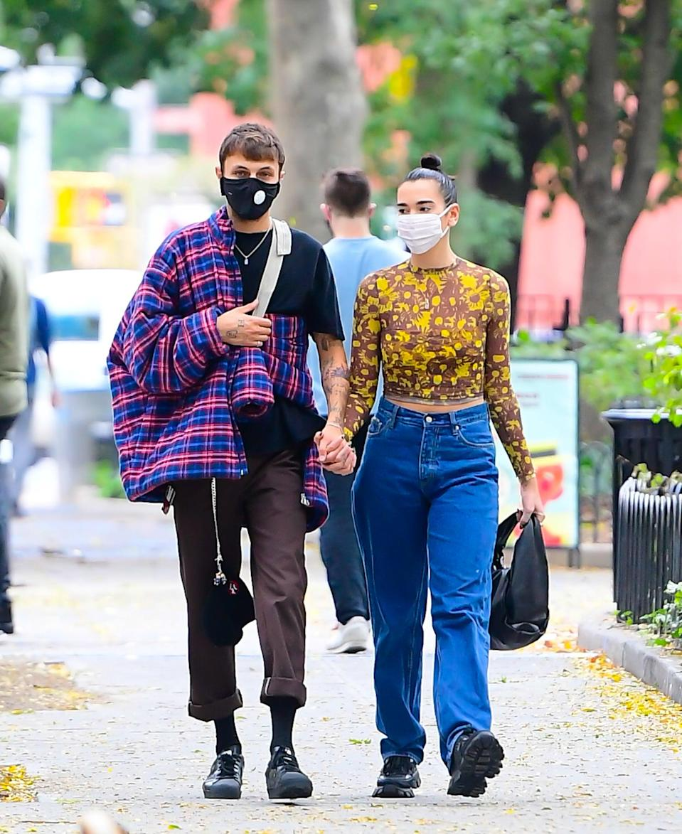 <p>We love that the couple isn't afraid of wearing bold prints. Plus, check out their awesome chunky shoes. </p>
