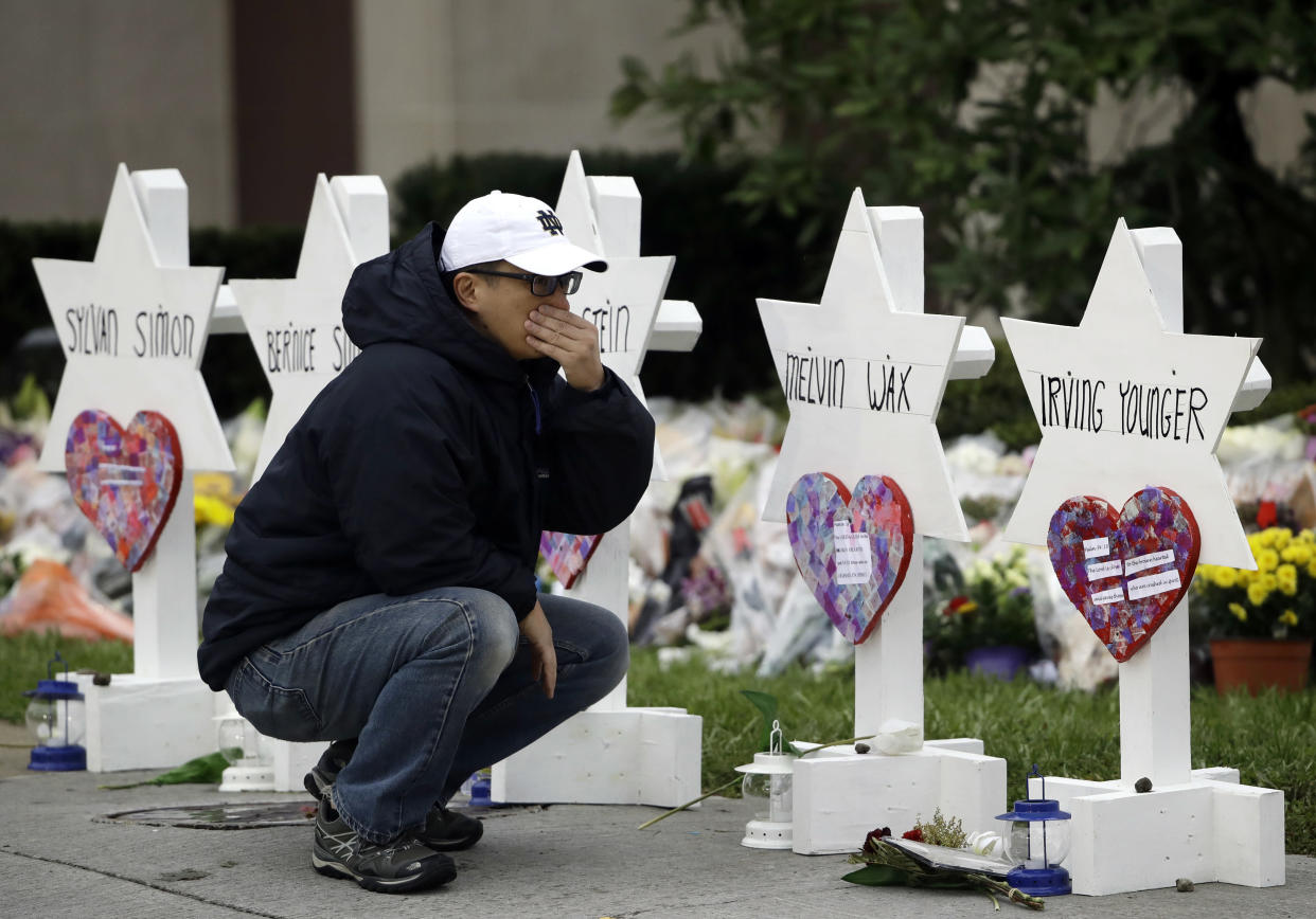A mourner pauses in front of a memorial for those killed in a deadly shooting at the Tree of Life synagogue in Pittsburgh, Oct. 29, 2018. (Photo: Matt Rourke/AP)
