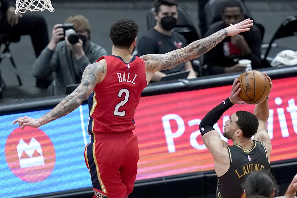 Chicago Bulls' Zach LaVine, right, pump-fakes New Orleans Pelicans' Lonzo Ball during the second half of an NBA basketball game Wednesday, Feb. 10, 2021, in Chicago. (AP Photo/Charles Rex Arbogast)