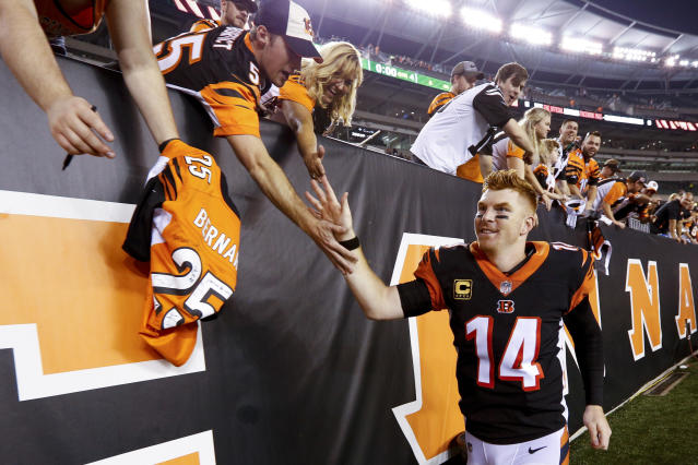 Cincinnati Bengals quarterback Andy Dalton (14) celebrates with fans after winning their NFL football game against the Baltimore Ravens, Thursday, Sept. 13, 2018, in Cincinnati. Bengals won 34-23. (AP Photo/Frank Victores)
