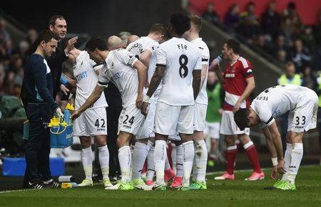 Swansea City manager Paul Clement speaks to players during the game