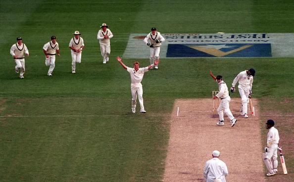 28  Dec 1999:  Australian players rush to congratulate debut Test pace bowler Brett Lee, after he had Indian batsman Javigal Srinath out caught by Mark Waugh for one run on day three of the second test match between Australia and India, played at the Melbourne Cricket Ground, Melbourne, Australia. Lee finished the day with five wickets for forty four runs. Mandatory Credit: Jack Atley/ALLSPORT