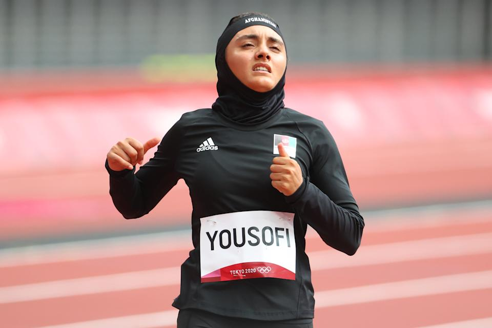 TOKYO, JAPAN - JULY 30: Kimia Yousofi of Team Afghanistan reacts after her performance during the Women's 100 meter preliminary round on day seven of the Tokyo 2020 Olympic Games at Olympic Stadium on July 30, 2021 in Tokyo, Japan. (Photo by Abbie Parr/Getty Images)
