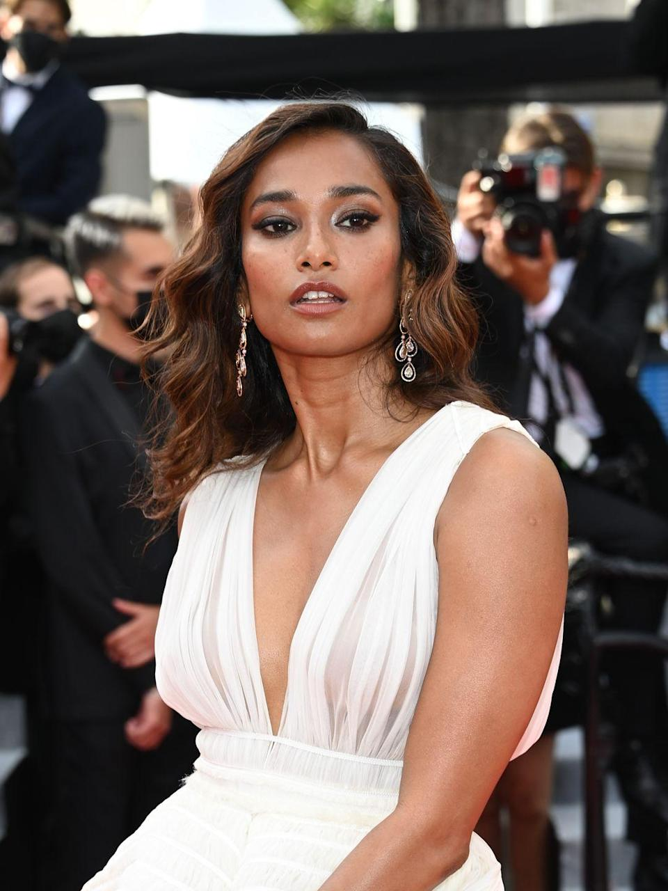 <p>The model and actress appeared at the première of Tout S'est Bien Passé by François Ozon wearing a pair of rose gold earrings set with more than nine carats of coloured diamonds by Chopard. </p>