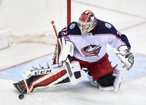 Columbus Blue Jackets goaltender Sergei Bobrovsky (72), of Russia, kicks away the puck during the third period in Game 2 of an NHL first-round hockey playoff series against the Washington Capitals, Sunday, April 15, 2018, in Washington. (AP Photo/Nick Wass)