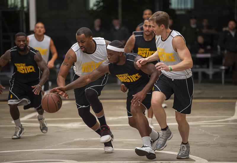 """In this Thursday, Dec. 12, 2019 photo, inmates play inmates during the first NBA """"Play for Justice"""" event hosted by the Sacramento Kings and the Represent Justice Campaign at Folsom State Prison in Folsom, Calif.  (Paul Kitagaki Jr./The Sacramento Bee via AP, Pool)"""