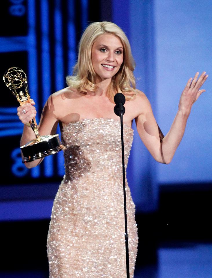 """<b>WORST: Claire Danes' Lack of Surprise</b><br> Danes barely blinked when she was named the winner of Best Actress in a TV Movie, and she strode up on stage like she'd done it a dozen times already that night. Couldn't you at least <i>pretend</i> to be surprised?<br><br>  <a href=""""http://www.televisionwithoutpity.com/show/emmy_awards/emmy_awards_2010_best_and_wors.php?__source=tw yhtv&par=yhtv"""">Source: TWoP</a>"""