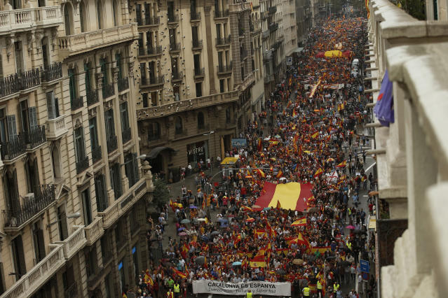 "<p>Demonstrators holding a banner that reads ""Catalonia is Spain"" march defending the unity of Spain and against a disputed referendum on the region's independence that separatist politicians want to hold Sunday, in Barcelona Saturday, Sept. 30 2017. (Photo: Manu Fernandez/AP) </p>"