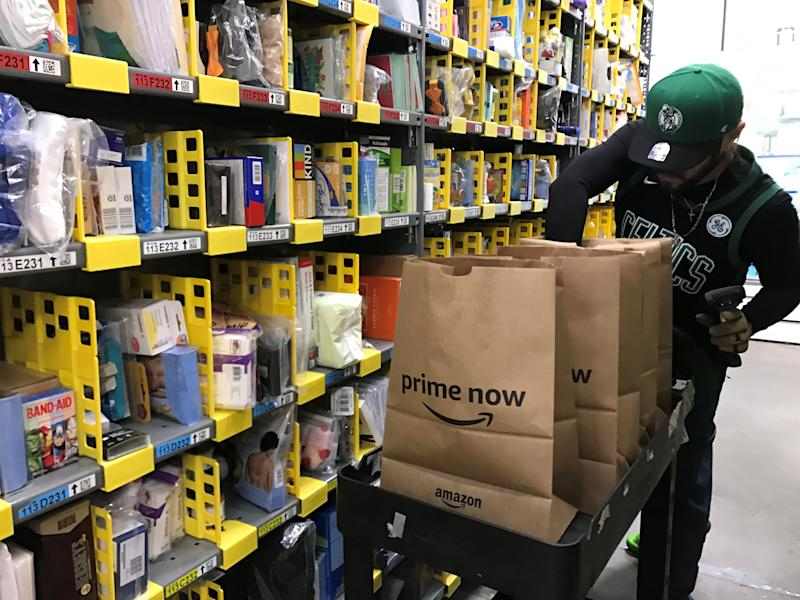 An employee collects items ordered by Amazon.com customers through the company's two-hour delivery service Prime Now in a warehouse in San Francisco, California, U.S., December 20, 2017. REUTERS/Jeffrey Dastin