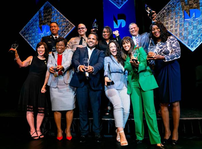 From left to right: Teresa Ellen Murphy, Brandon Webb, Sheila Jones-Coakley, Brian Rafky, Cesar F. Larancuent, Caridad Cuellar, Betsy Godoy-Rosado, Jessica Gutierrez-Castillo, Pete Gomez and Shirley N. Codada celebrate after being inducted in Miami Dade College's Alumni Hall of Fame at the school's Wolfson Campus in downtown Miami on Wednesday, June 9, 2021. MDC recognized ten alumni on the frontlines of the coronavirus pandemic in a special heroes edition of the annual Alumni Hall of Fame induction ceremony.