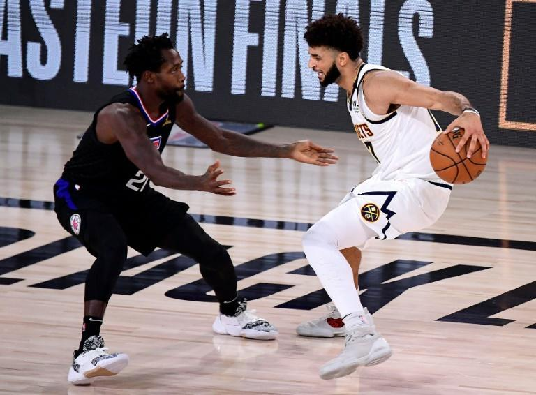 Denver star Jamal Murray (right) drives the ball against Patrick Beverley of the LA Clippers during the fourth quarter of the Nuggets 104-89 game seven upset win to book their spot in the Western Conference finals