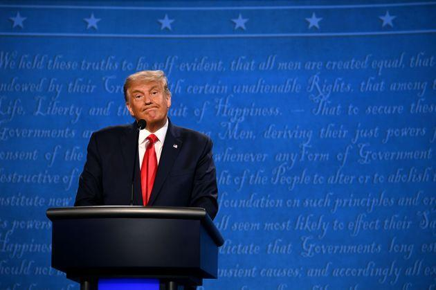 President Donald Trump reacts during the final presidential debate at Belmont University in Nashville, Tennessee.