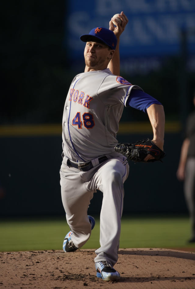 New York Mets starting pitcher Jacob deGrom throws against the Colorado Rockies during the first inning of a baseball game, Monday, June 18, 2018, in Denver. (AP Photo/Jack Dempsey)