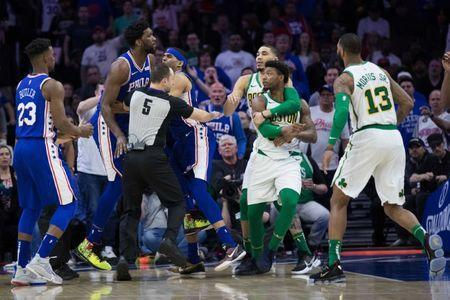 Mar 20, 2019; Philadelphia, PA, USA; Philadelphia 76ers center Joel Embiid (21) and Boston Celtics guard Marcus Smart (36) are separated by teammates after an altercation during the third quarter at Wells Fargo Center. Mandatory Credit: Bill Streicher-USA TODAY Sports