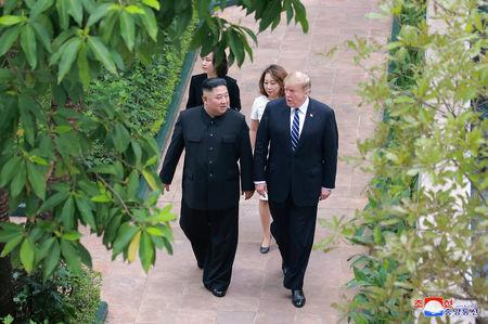 North Korea's leader Kim Jong Un walks with U.S. President Donald Trump during the second North Korea-U.S. summit in Hanoi, Vietnam, in this photo released on March 1, 2019 by North Korea's Korean Central News Agency (KCNA).  KCNA via REUTERS    ATTENTION EDITORS - THIS IMAGE WAS PROVIDED BY A THIRD PARTY. REUTERS IS UNABLE TO INDEPENDENTLY VERIFY THIS IMAGE. NO THIRD PARTY SALES. SOUTH KOREA OUT. NO COMMERCIAL OR EDITORIAL SALES IN SOUTH KOREA.
