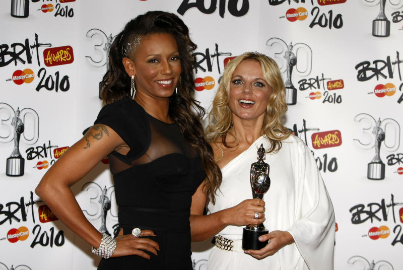Former Spice Girls Geri Haliwell, right, and Mel B with their Brit Award for Best British Performance over the last 30 years for Wannabe by the Spice Girls at the 2010 Brit Awards in London, Tuesday, Feb. 16, 2010 . (AP Photo/ Alastair Grant)