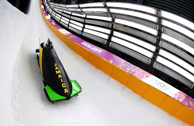 SOCHI, RUSSIA - FEBRUARY 14: Winston Watts of Jamaica pilots a run during a Men's Two-Man Bobsleigh training session on day 7 of the Sochi 2014 Winter Olympics at the Sanki Sliding Center on February 14, 2014 in Sochi, Russia. (Photo by Al Bello/Getty Images)