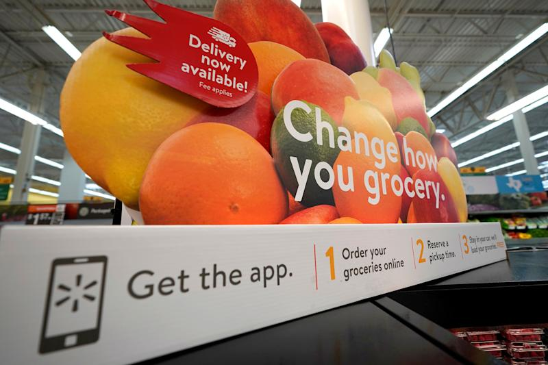A sign promotes online and home delivery of groceries at a Walmart Supercenter Friday, Nov. 9, 2018, in Houston. (AP Photo/David J. Phillip)
