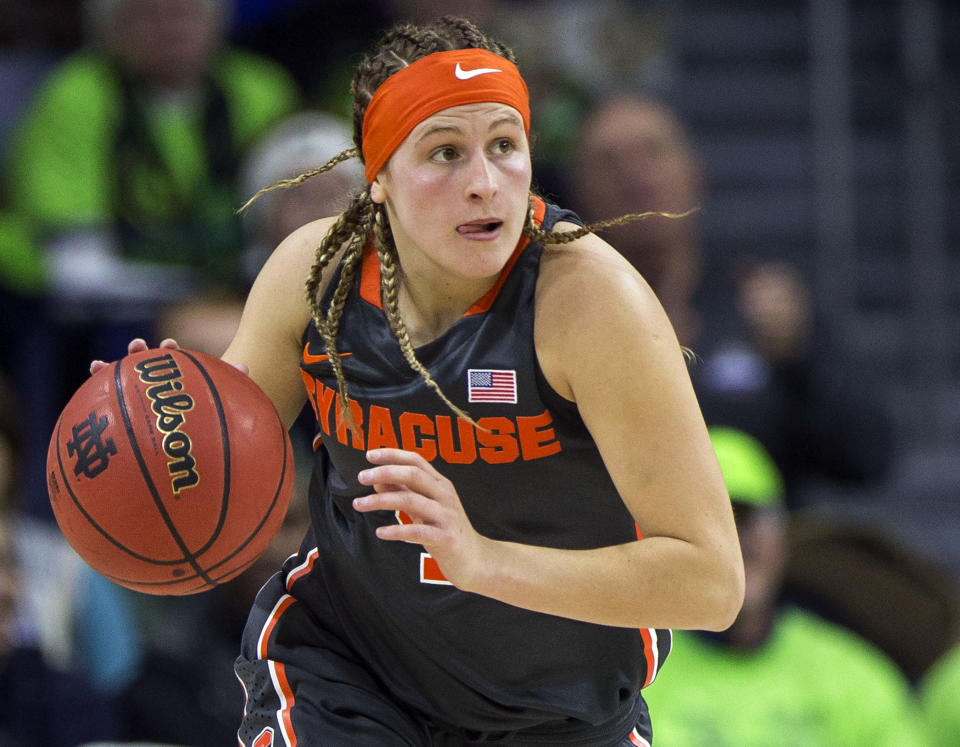FILE — In this Dec. 28, 2017 file photo, Syracuse's Tiana Mangakahia drives downcourt during the second half of an NCAA college basketball game against Notre Dame, in South Bend, Ind. In spite of everything that's been thrown her way, the smile of Syracuse point guard Tiana Mangakahia and her effervescent persona remain as infectious as ever in the waning weeks of her final season in college. It's in her DNA. (AP Photo/Robert Franklin, File)
