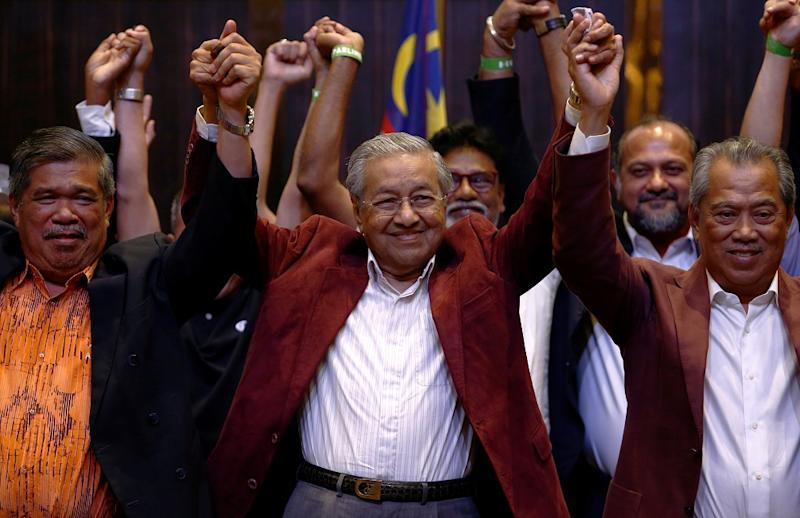 Tun Dr Mahathir Mohamad reacts after winning GE14 back in May last year. — Reuters pic