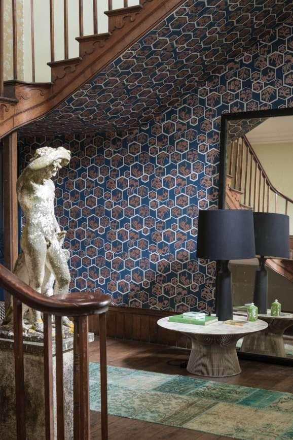 """<p>Not an inch of space is neglected here, as the Shouchikubai wallpaper from Farrow & Ball travels seamlessly from the wall to under the stairs. Cast around your home for forgotten areas, or corners that you have disregarded for fresh wallpapering opportunities. </p><p>Pictured: <a href=""""https://go.redirectingat.com?id=127X1599956&url=https%3A%2F%2Fwww.farrow-ball.com%2Fwallpaper%2Fshouchikubai%3Fsku%3D5051836582111&sref=https%3A%2F%2Fwww.countryliving.com%2Fuk%2Fhomes-interiors%2Fg36953751%2Fwallpaper-ideas%2F"""" rel=""""nofollow noopener"""" target=""""_blank"""" data-ylk=""""slk:Shouchikubai"""" class=""""link rapid-noclick-resp"""">Shouchikubai</a>, Farrow & Ball</p>"""