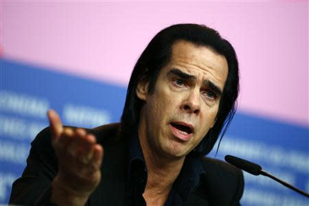 "Cast member Nick Cave talks during a news conference promoting the movie ""20,000 Days on Earth"" at the 64th Berlinale International Film Festival in Berlin February 10, 2014. REUTERS/Thomas Peter"